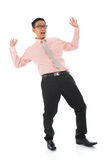 Shocked young Asian businessman Stock Images