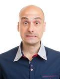 Shocked young bald man Stock Photos