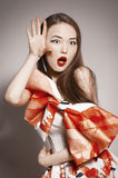 Shocked young beautiful asian brunette Stock Images