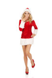Shocked young beautiful santa woman Royalty Free Stock Photography