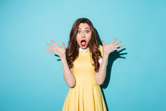 Shocked young brunette woman Stock Image