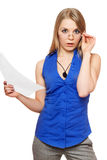 Shocked young business woman in glasses. With a paper documant Royalty Free Stock Image
