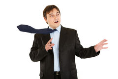 Shocked  young businessman with blowing tie Royalty Free Stock Photo