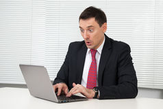 Shocked young businessman Stock Image