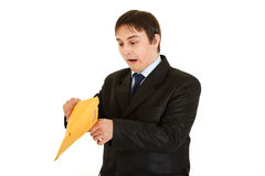 Shocked young businessman checking parcel Stock Photography