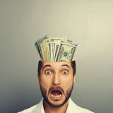 Shocked young businessman with money Royalty Free Stock Photography