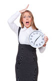 Shocked young businesswoman. Holding the clock. isolated on white background Stock Images