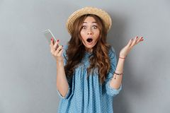 Shocked young caucasian lady talking by phone. Image of shocked young caucasian lady talking by phone. Looking camera Stock Image