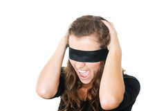 Shocked young female with blindfold Stock Image