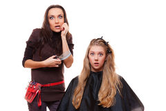 Shocked young girl and hairdresser stock photography