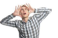 Shocked young man. Over white stock photo