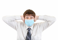 Shocked Young Man in Flu Mask Stock Images