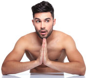 Shocked young man is praying Stock Photo