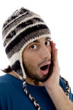 Shocked young man wearing winter hat Stock Image