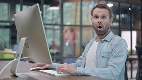 Shocked young man wondering in awe. The shocked young man wondering in awe stock video