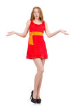 Shocked young nice girl in red dress isolated on Stock Photography