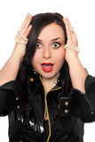 Shocked young woman in black jacket Royalty Free Stock Photos