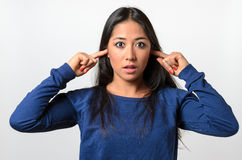 Shocked young woman blocking her ears Stock Photography