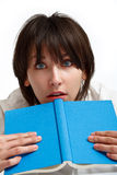 Shocked young woman with a book Royalty Free Stock Photo