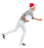 Shocked young woman and christmas hat running with clock Stock Photography