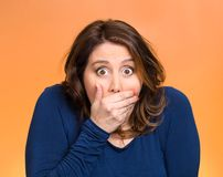 Shocked young woman, covering her mouth Stock Images