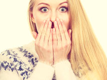 Shocked young woman covering mouth with hand Stock Image