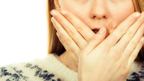 Shocked young woman covering mouth with hand Royalty Free Stock Photography