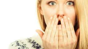 Shocked young woman covering mouth with hand Stock Photos