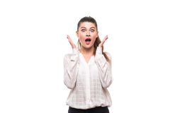 Shocked young woman covers her mouth with hands. On white isolated Royalty Free Stock Images