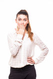 Shocked young woman covers her mouth with hands. On white isolated Stock Image