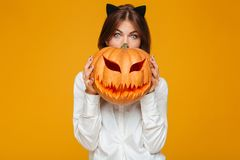 Shocked young woman dressed in crazy cat halloween costume Royalty Free Stock Image