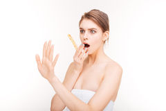 Shocked young woman with emery board looking at her nails Royalty Free Stock Images