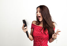 Shocked young woman with hair loss Royalty Free Stock Photography
