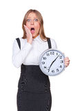 Shocked young woman holding the clock. Isolated on white background Stock Images