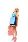 Shocked young woman holding shopping bags Stock Images