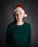 Shocked young woman in Santa hat. Shocked young woman in Santa hat on grey background Royalty Free Stock Images