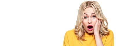 Shocked young woman, screaming in disbelief, isolated over white. Banner with copy space. Shocked young woman, screaming in disbelief, isolated over white stock photography