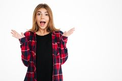 Shocked young woman standing isolated Stock Photo
