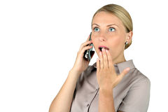 Shocked Young woman  Talking on Cell Phone Stock Images