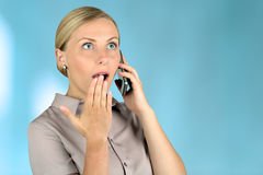 Shocked Young woman  Talking on Cell Phone Stock Photography