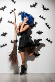 Shocked young woman in witch halloween costume Stock Image
