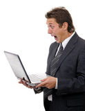 Shocking businessman reading message on laptop Royalty Free Stock Photo