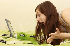 Shocking internet. A young woman is blown away by the information found on the Internet Stock Images