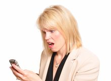 Shocking news. Working businesswoman receiving shocking news Royalty Free Stock Photography