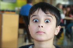 Shocking News. Surprised boy makes a scared, shocked face at the news he has been told Royalty Free Stock Photo