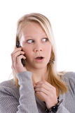 Shocking news. Young blond girl on the phone looking shocked Stock Photo