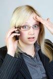Shocking news. Business woman gets shocking news Royalty Free Stock Image