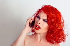 Shocking Phone talk. Shocked unhappy woman talking at mobile phone listening receiving very bad shocking news. Isolated white back royalty free stock images