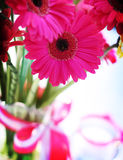 Shocking Pink Gerbera. S are arrayed in a lovely arrangement as a wedding table center piece Stock Photo