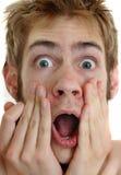 Shocking Surprise. A shocking surprise to a young man screaming Royalty Free Stock Image